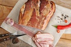 A piece of smoked pork - loin on a linen napkin Royalty Free Stock Photos