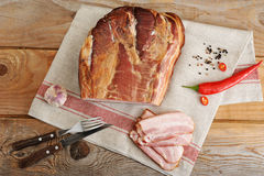 A piece of smoked pork - loin on a linen napkin Stock Image