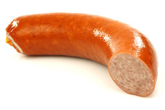 A piece of smoked sausage. On a white background Royalty Free Stock Photography