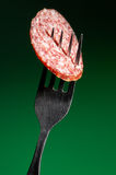 Piece of smoked sausage Royalty Free Stock Photography