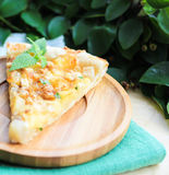 Piece of snack puff pastry pie or quiche with camembert cheese, pear, walnuts and fresh mint Stock Photography
