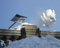 Piece of snow. Cleaning of snow from roofs Stock Images