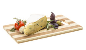 A piece of soft brie cheese Stock Image