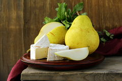 Piece of soft cheese with and pears Stock Images