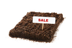 Piece of soil with sale title Stock Photos
