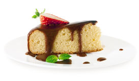 A piece of sponge cake with chocolate sauce . Stock Image