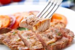Piece of steak on fork Stock Photo