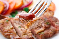 Piece of steak on fork Stock Images