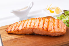 Piece of steak grilled fish. On a wooden board Royalty Free Stock Photo