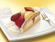 Piece of strawberry cake Stock Images