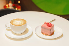 Piece of strawberry cake and cup of coffee Stock Photo