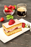 Piece of strawberry cake. With whipped cream and fresh berries Stock Images