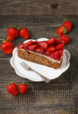 Piece of strawberry cake on white ceramic cake stand Royalty Free Stock Images