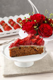 Piece of strawberry cake on white ceramic cake stand Stock Image