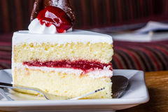 Piece of strawberry cake Stock Photos