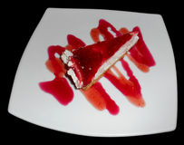 Piece of strawberry cheescake, isolated Stock Photography