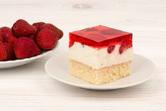 A piece of strawberry cheesecake on the wooden background. Stock Photo