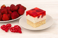 A piece of strawberry cheesecake on the wooden background. Stock Image