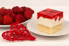 A piece of strawberry cheesecake on the wooden background. Royalty Free Stock Photography