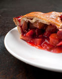 Piece of strawberry and rhubarb pie Royalty Free Stock Image