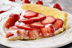 Piece of strawberry tart. Festive and party dessert Royalty Free Stock Image