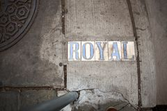 Royal sign imprinted in pavement stock images
