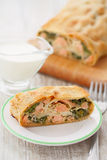 Piece strudel with fish and spinach Stock Images