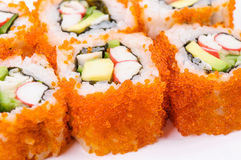 Piece sushi with crab meat, avocado and red caviar Royalty Free Stock Photography