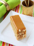 Piece of sweet cake with caramel cream Royalty Free Stock Image