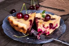 Piece of sweet cherry clafouti. Summer pie. royalty free stock photo