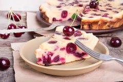 Piece of sweet cherry clafouti. Summer pie. stock photos
