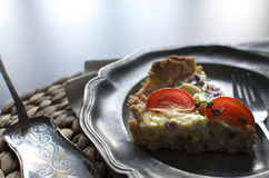 A piece of tart on a tin plate Stock Photography