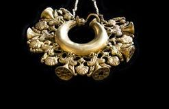 Piece of tartessos hoard of Aliseda, Caceres, Spain. Aliseda, Spain - October 29, 2017: Gold pendantPatera, piece of tartessos treasure gold of Aliseda. Replica stock photography