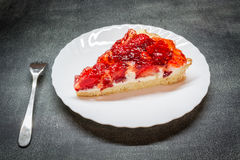 Piece tarts with strawberries. On a plate Stock Images