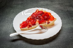 Piece tarts with strawberries. On a plate Stock Photos