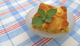 A piece of tasty apple pie with mint Stock Photo