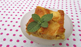 A piece of tasty apple pie with mint Royalty Free Stock Images