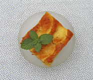 A  piece of tasty apple pie with mint Stock Images