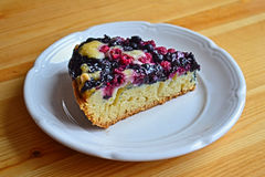 Piece of tasty cake with wild berries Royalty Free Stock Photography