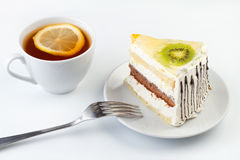 Piece of tasty creamy cake with fruits Royalty Free Stock Photography