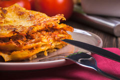 Piece of tasty hot lasagna on a plate Stock Photo