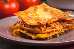 Piece of tasty hot lasagna on a plate Stock Photography
