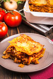 Piece of tasty hot lasagna on a plate Royalty Free Stock Photos