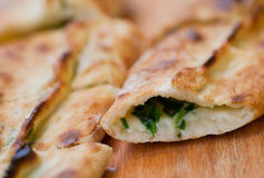 Piece of tasty Pide, turkish homemade pizza with cheese, spinach and herbs Royalty Free Stock Photos