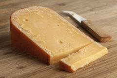 Piece of three year old Gouda cheese Royalty Free Stock Photo