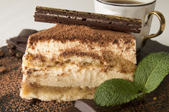 Piece of tiramisu cake on black slate stock image
