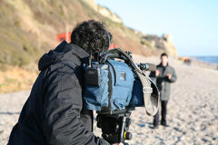 Piece to Camera. TV footage being filmed on Branscombe beach amongst the debris of the Napoli wreckage Stock Photography
