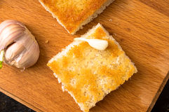 Piece of toasted bread with garlic Royalty Free Stock Photo