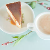 Piece of toffee cheesecake with small americana coffee Stock Image