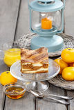 Piece of toffee and vanilla cake on transparent glass cake stand Stock Photo